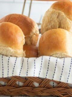 dinner rolls in a wooden basket