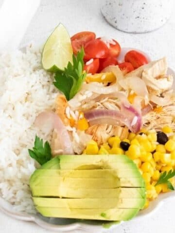 fajita bowl with tons of toppings on a white counter