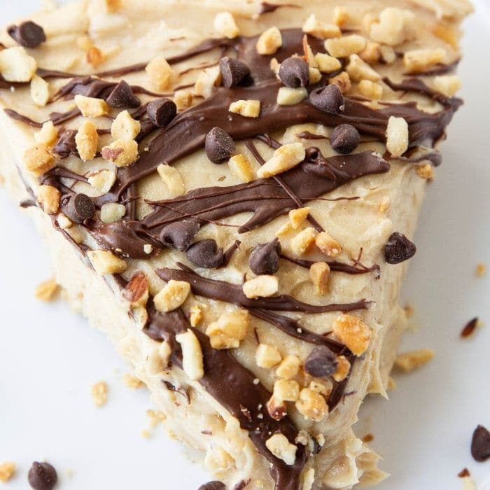 no bake pb pie on plate with nuts and chocolate chips by it