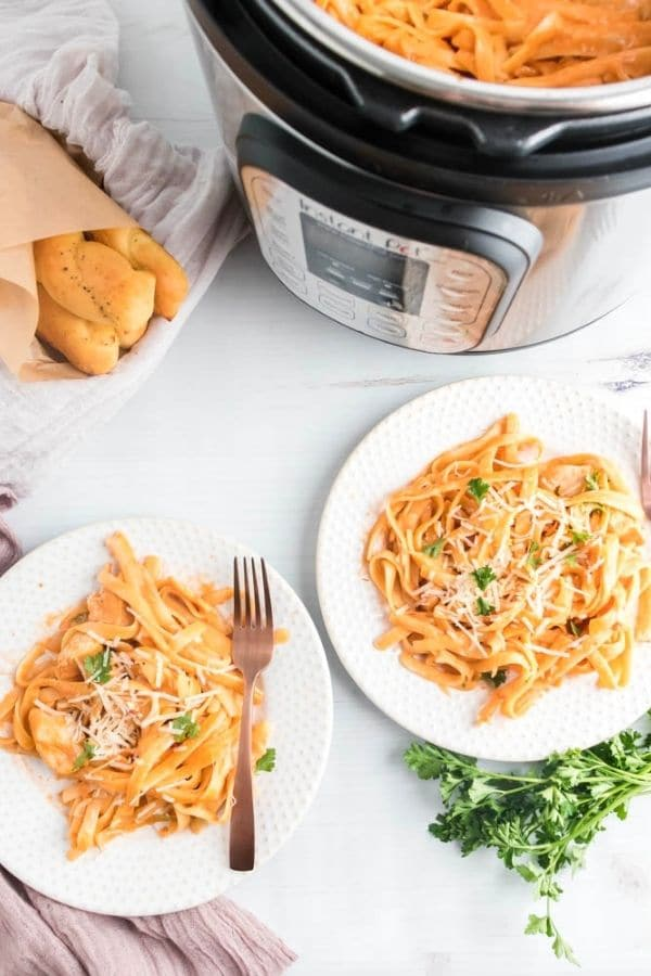 plates of pasta sacue with instant pot by it