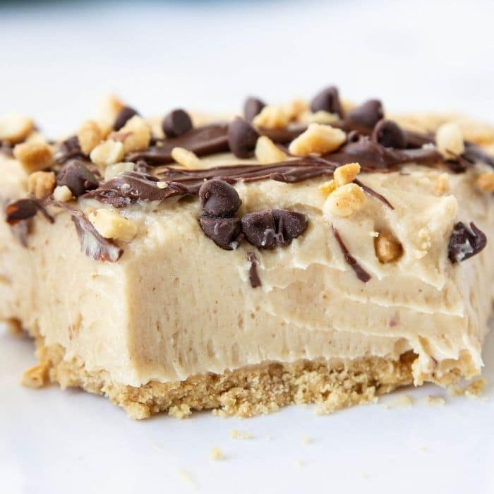 peanut butter cream cheese pie with a piece cut out of it