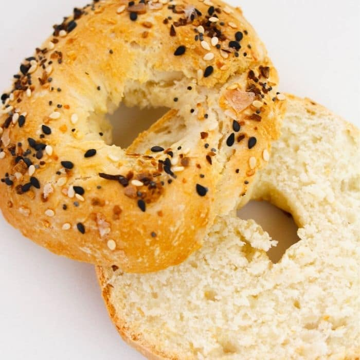 sliced bagel on counter with everything bagel seasoning on top