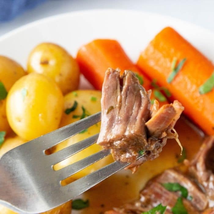 fork with pot roast on it