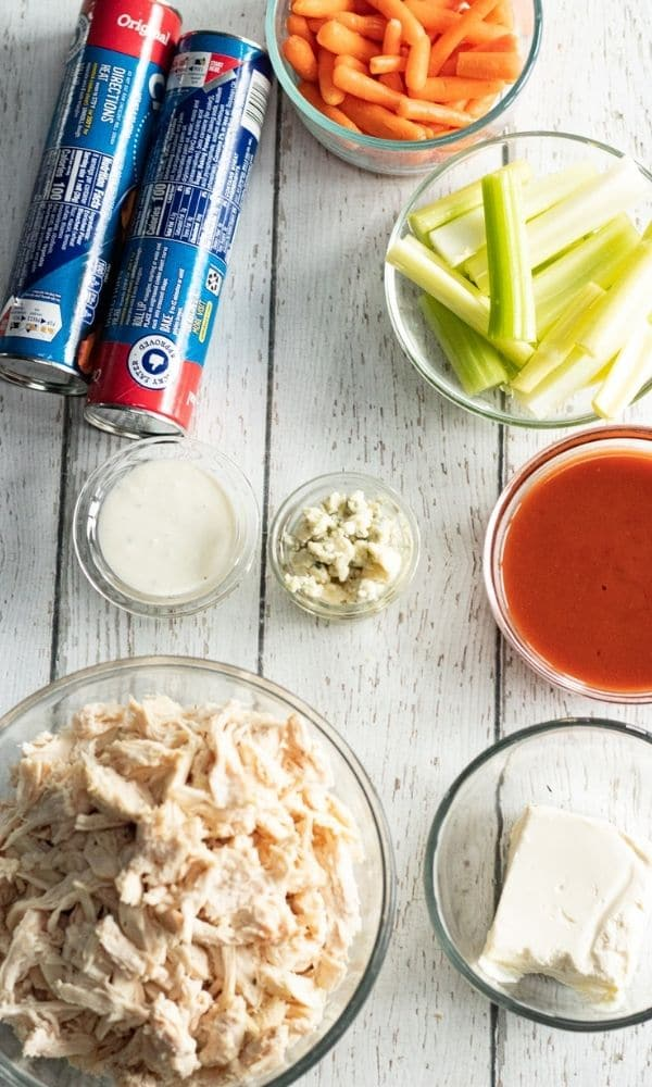 buffalo chicken appetizer ingredients on wooden counter