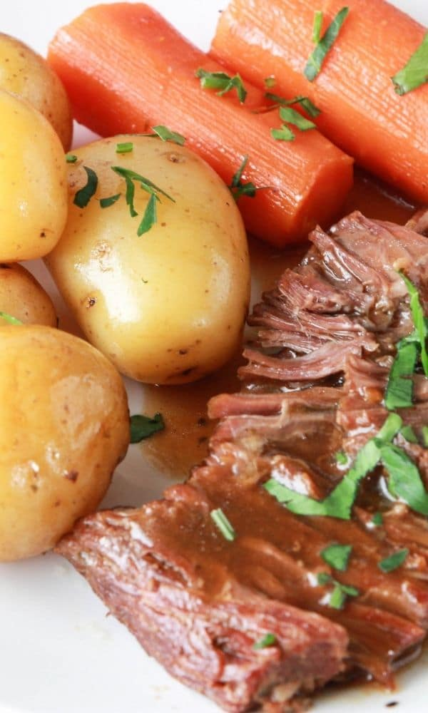 plate with potatoes, carrots of beef
