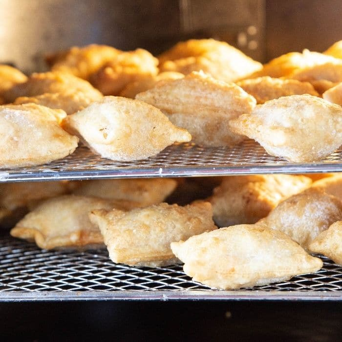 picture of pizza rolls on air fryer oven trays