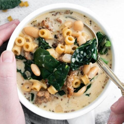 Instant Pot Pasta E Fagioli Soup in a bowl being held with spoon