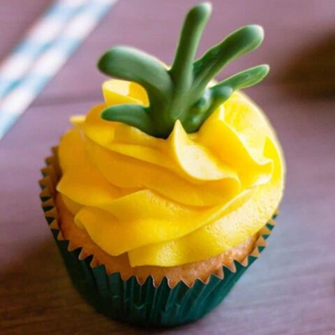 cupcake on counter with yellow frosting