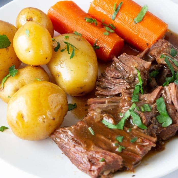 roast and potatoes and carrots on a plate