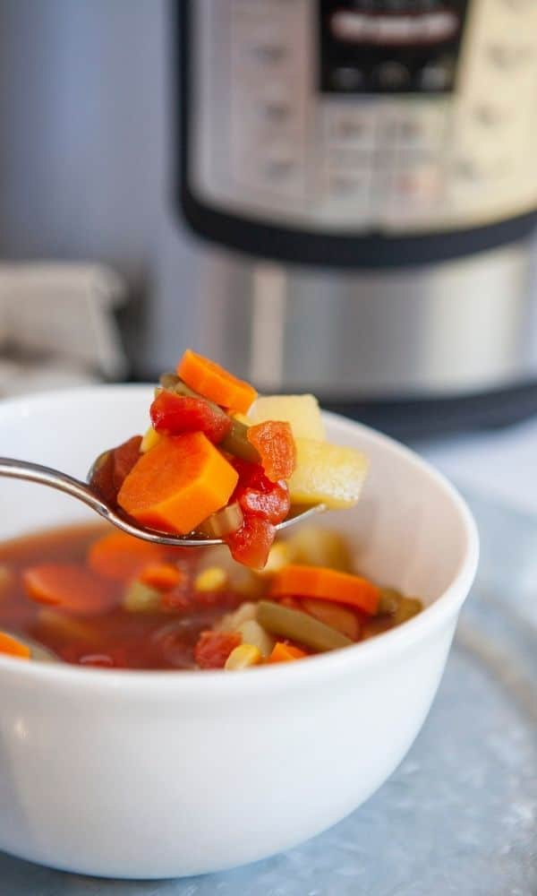 vegetarian soup in a bowl with spoon