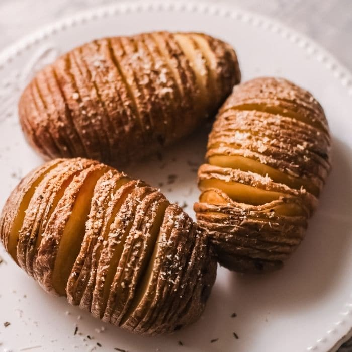 plate with air fryer hasselback potatoes