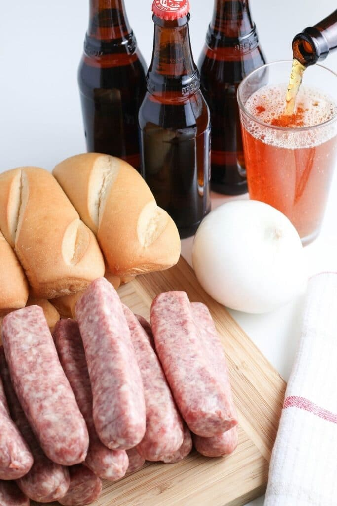 raw brats, buns, and beer on counter