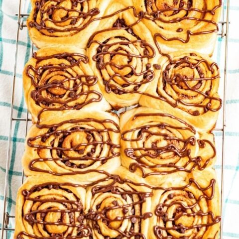 chocolate chip cinnamon rolls in a baking pan