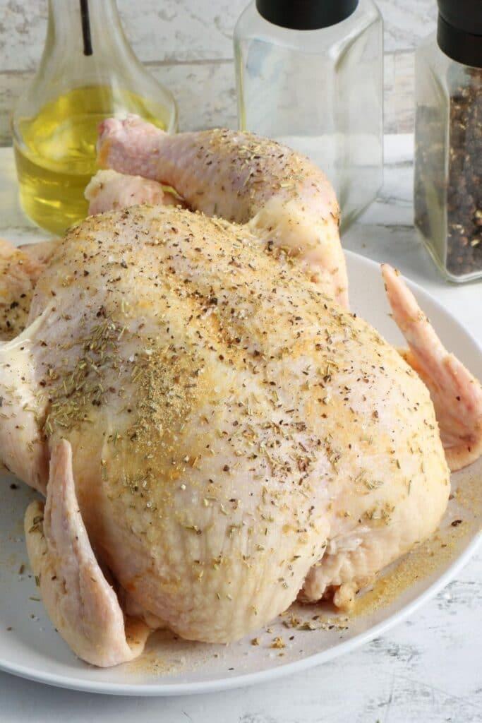 seasoned raw chicken on table