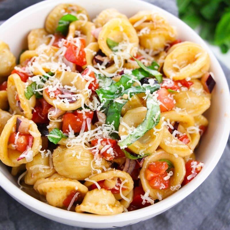 bruschetta pasta in a white bowl with napkin around it