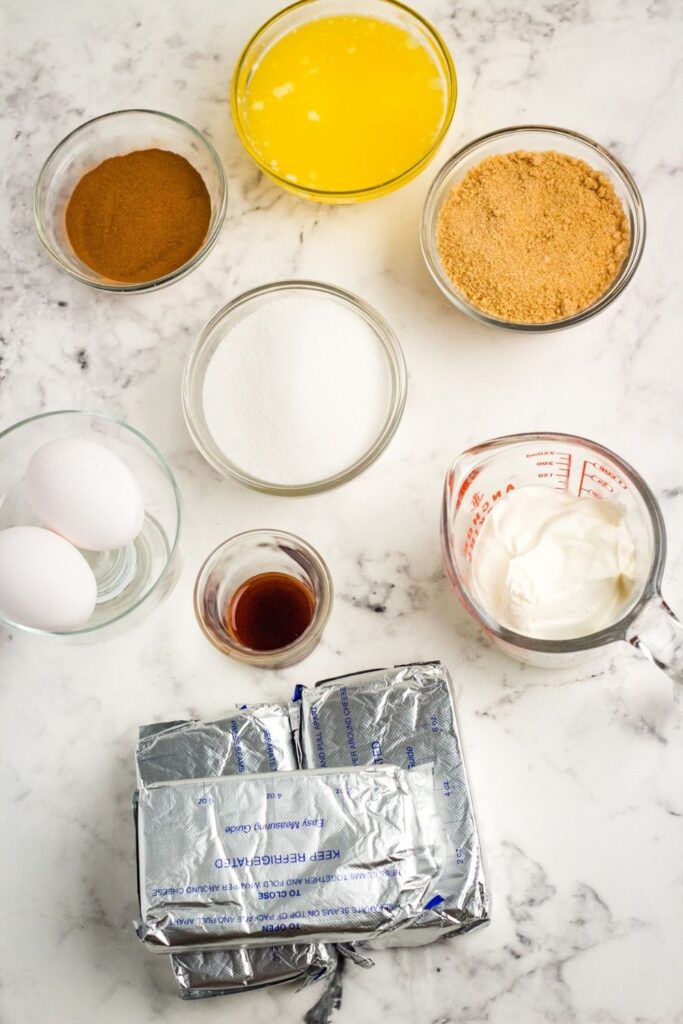 all ingredients for cheesecake on table