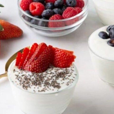 yogurt in cups on table