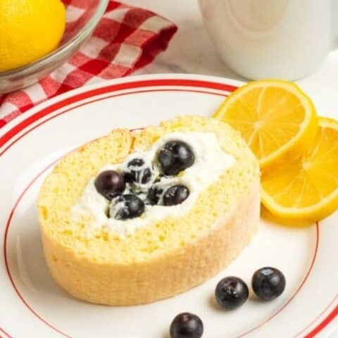 lemon loaf on a plate with blueberries