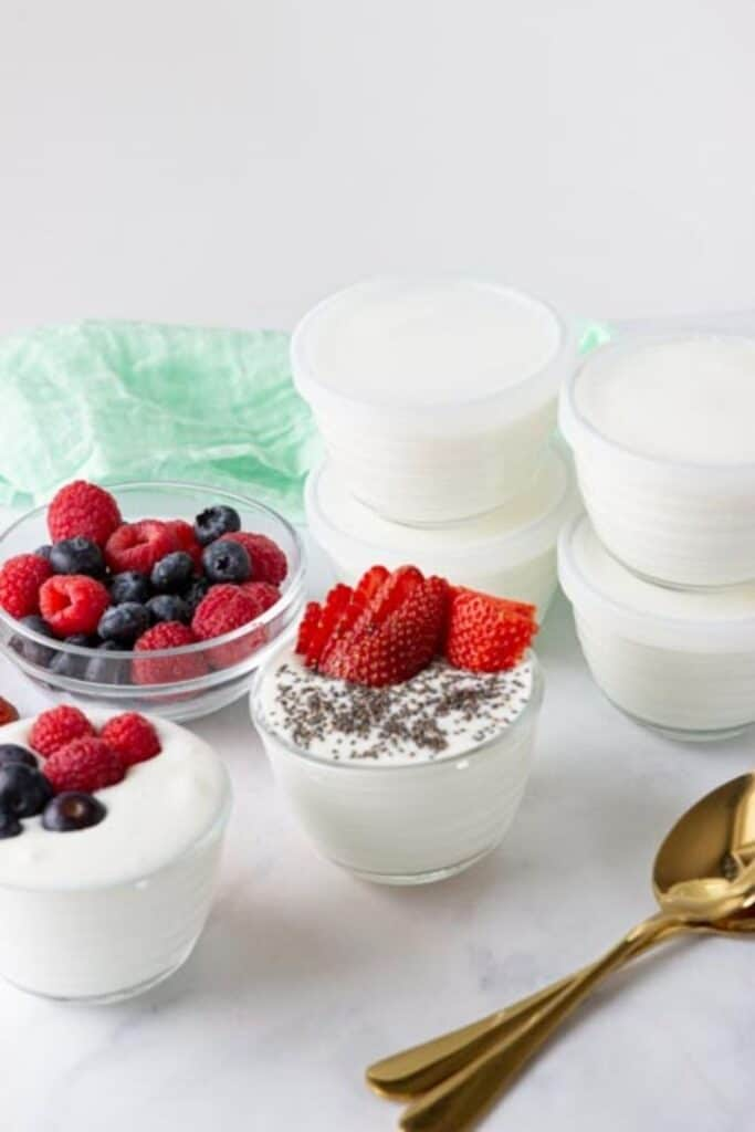 yogurt in bowls with spoon by it