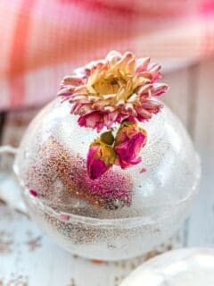 floral tea bomb on the counter with dried flower on top