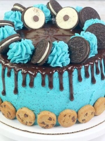 cookie monster cake on a cake stand