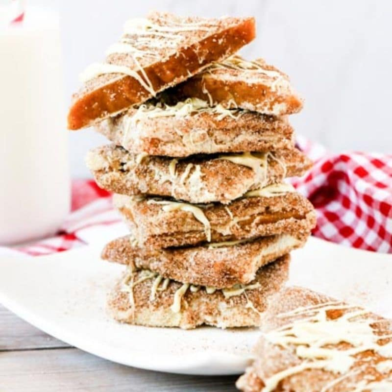 stacked toffee on white plate with napkin behind it
