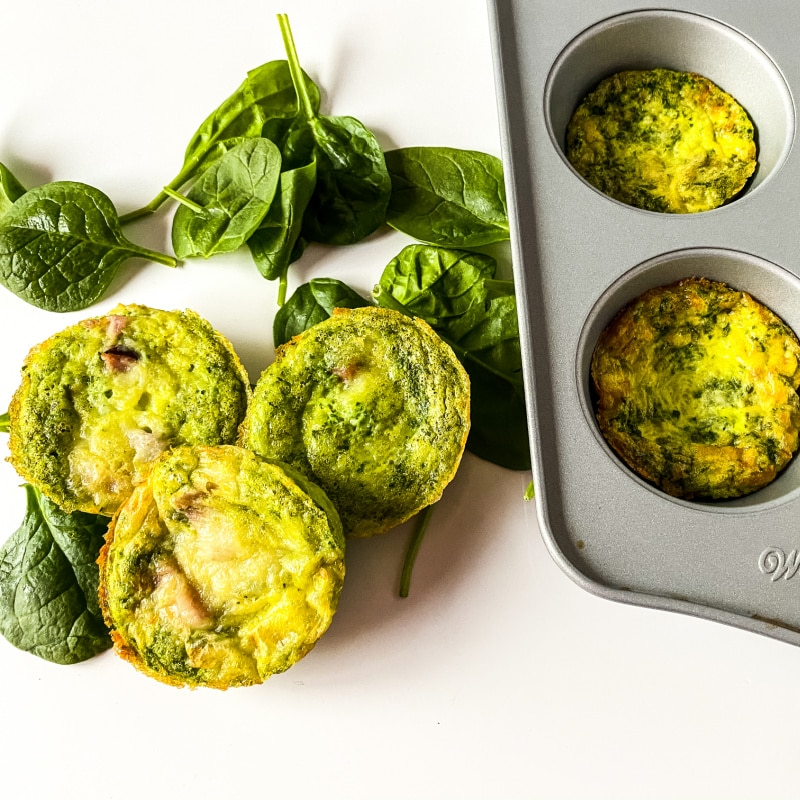 egg cups on counter by muffin tin