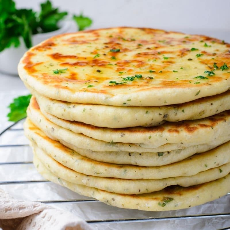 homemade flatbread stacked on top of each other