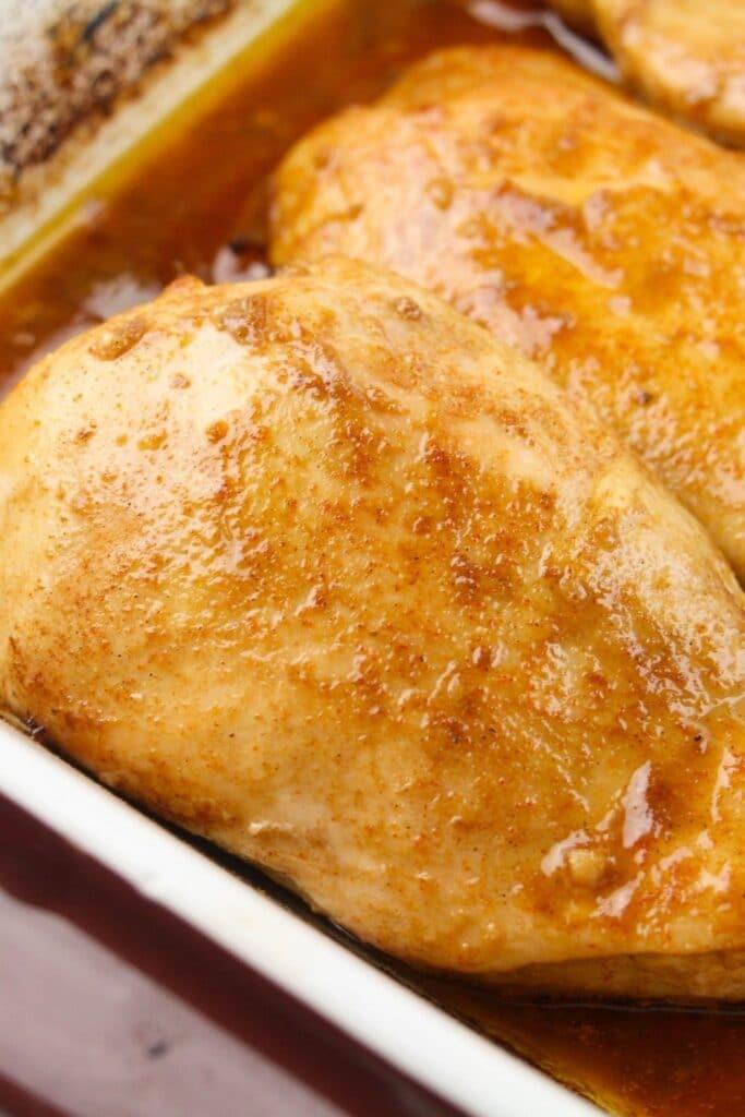 closeup of cooked boneless chicken in baking dish