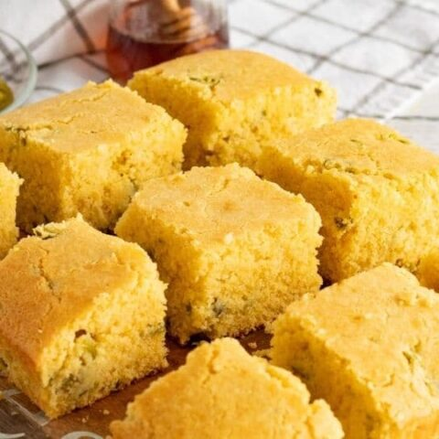 cornbread sliced up and placed on a cooling rack
