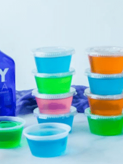 stacked jello shots with vodka by it