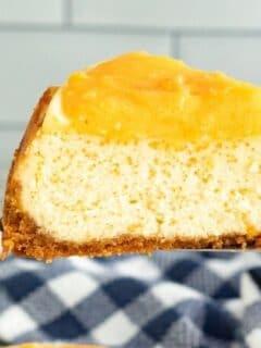 slice of orange cream cheesecake on spatula