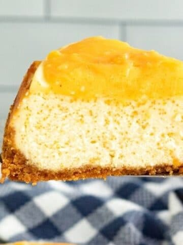 slice of orange cream cheesecake on spatula