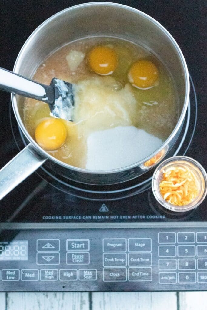making orange curd in pan