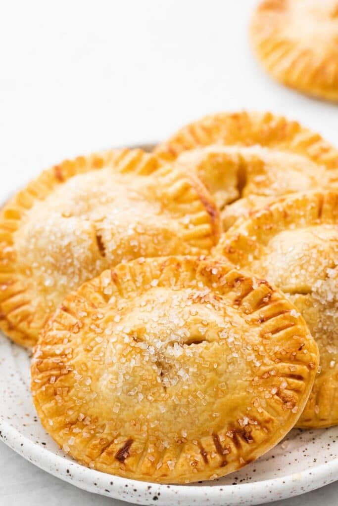 apple hand held pies on a plate