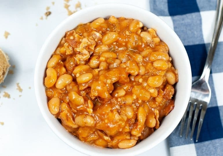baked beans in a bowl with fork by it