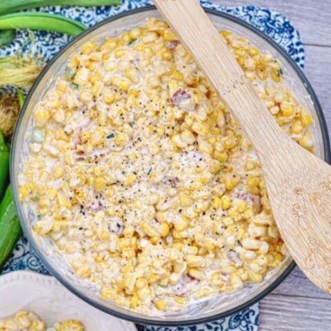 corn salad in a bowl with spoon on top