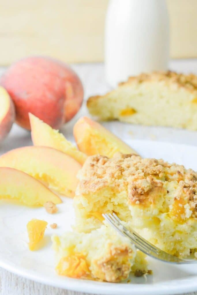 scone on a plate with peaches by it