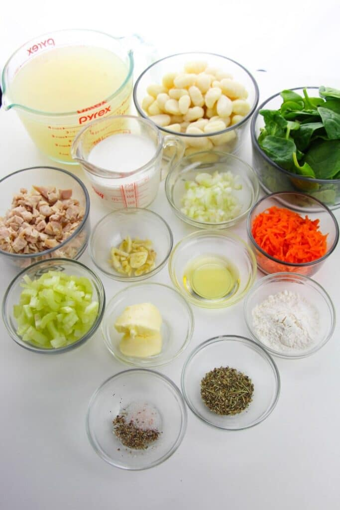 ingredients for gnocchi soup on white table