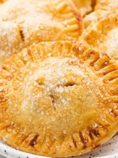 golden hand pies on a plate