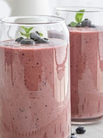 two glasses of acai smoothie on table