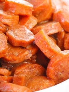 candied carrots in a white bowl