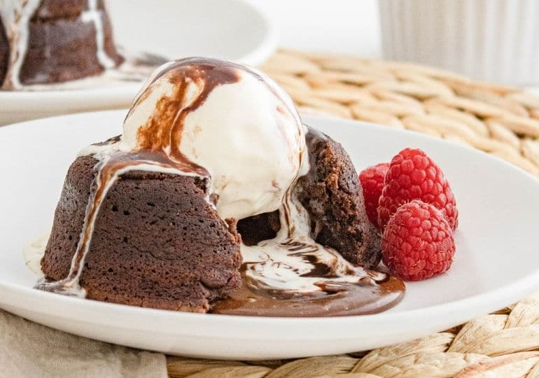 lava cake cut open on plate with ice cream on top