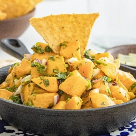 mango salsa in pan with chip stuck on top