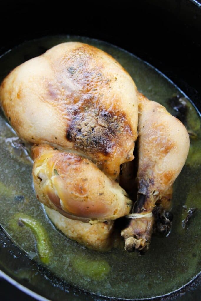 fully cooked whole chicken sitting in Crockpot