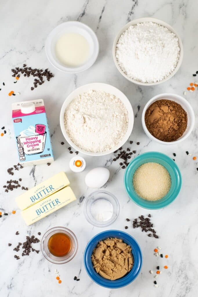 all ingredients for chocolate cookie bars on marble counter