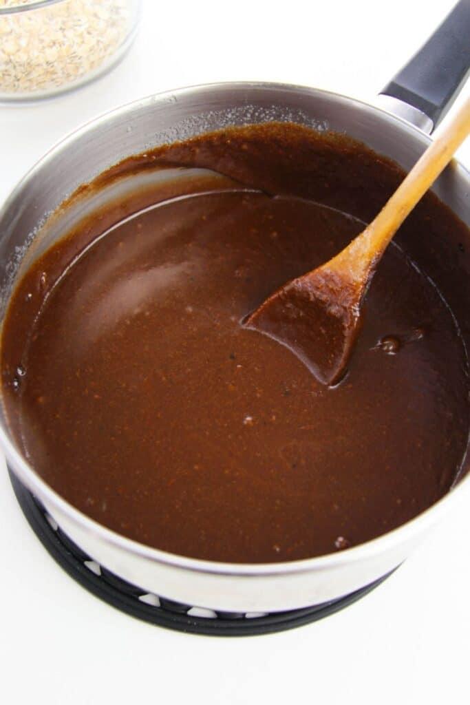 hazelnut cookie mixture in pot with wooden spoon in it