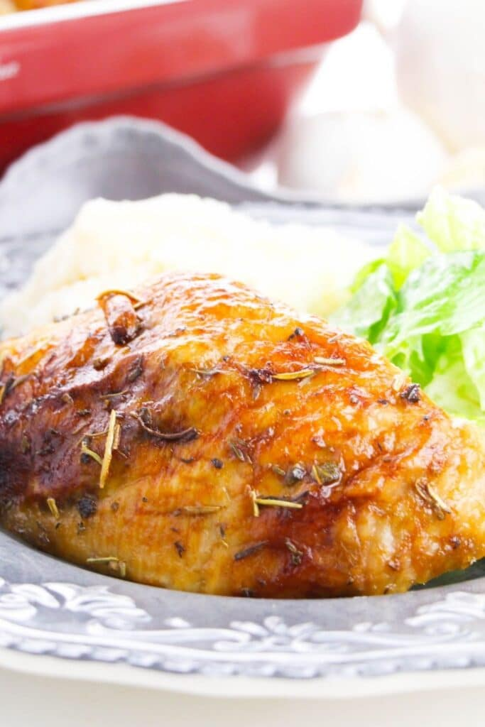 roast chicken on a plate with salad as well