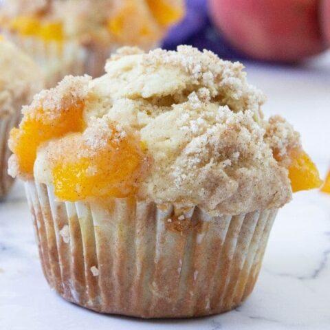 peach cobbler muffin on counter