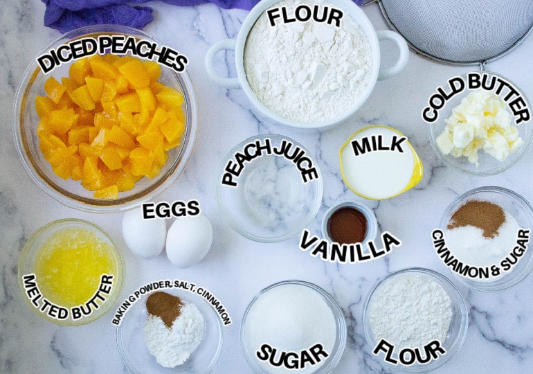ingredients of peach cobbler muffins on marble counter